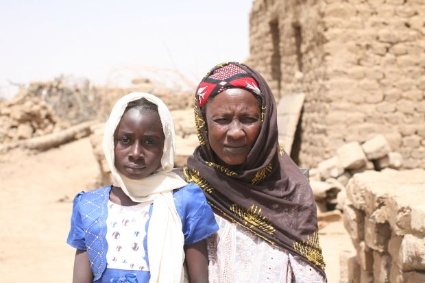 Nana with her grandmother in the compound of their home.