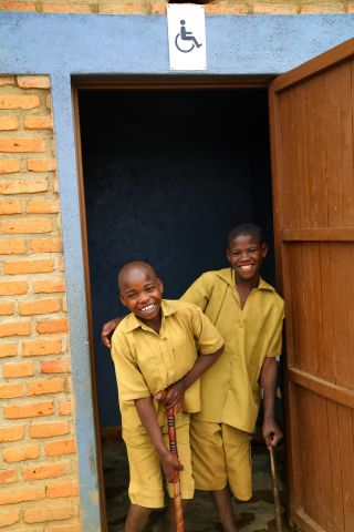 Thanks to the new handicap toilet, Salomon (right) and Innocent (left) have a comfortable study environment.