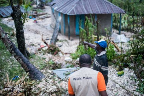 Farmers and World Vision Haiti assess the damage of Hurricane Matthew
