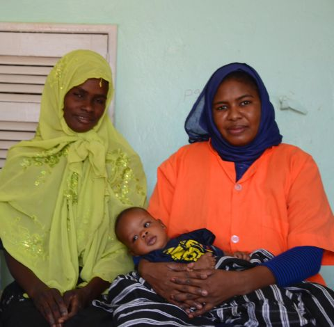 Mariem(in the left), sitting next to the Aminata, mother of baby Ibrahim, 2 months old , whom she helped giving birth