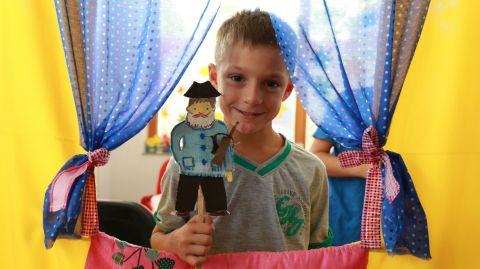 David participates in a small-scale puppet show