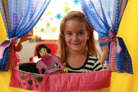 Katja is participating in a small-scale puppet show