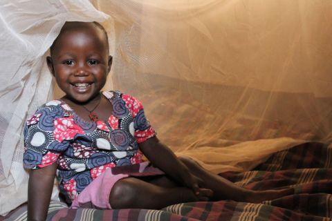 Girl under mosquito net
