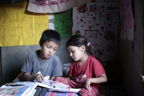 Jhalak studies with his sister at the reading corner at his home.