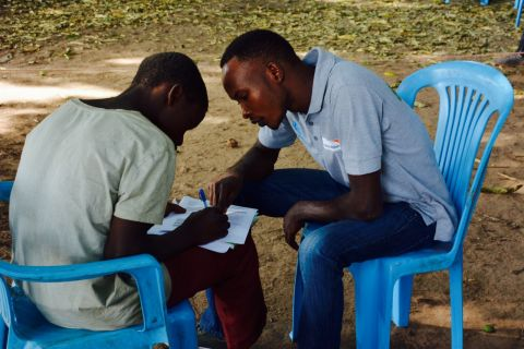World Vision social worker and client