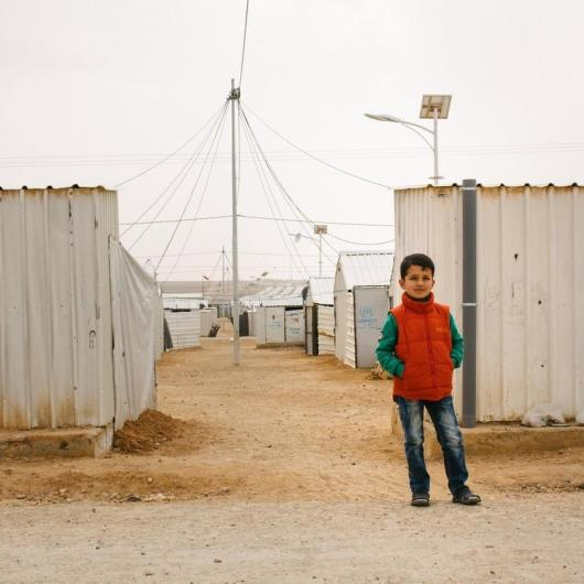 Syrian refugee boy in camp in Jordan