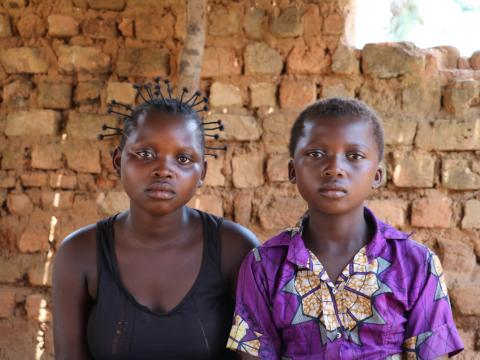 Sisters Mputu, 15, and Bakandi, 11 recently arrived in Dibaya. They grew up over 500km away, near Tshikapa in Kasai province, where the conflict turned their lives upside down this spring