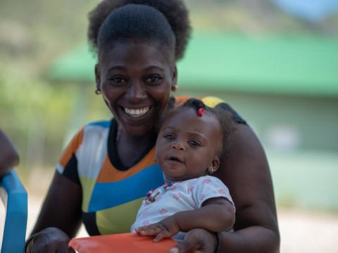 Mother and infant at Go Baby Go training in Haiti