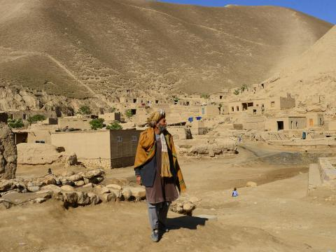An Afghan stands in a desert Badghi