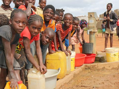 Children in Angola holding clean water