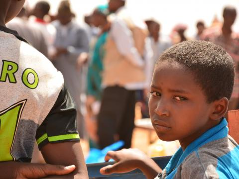 Child at the food distribution in Konio.JPG