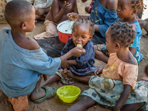 A baby is fed from her older brother in DRC