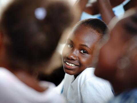 A Haitian girl smiles in school