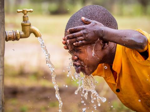 A child enjoys clean water