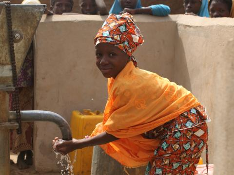 Habiba, 13, enjoys clean water.JPG