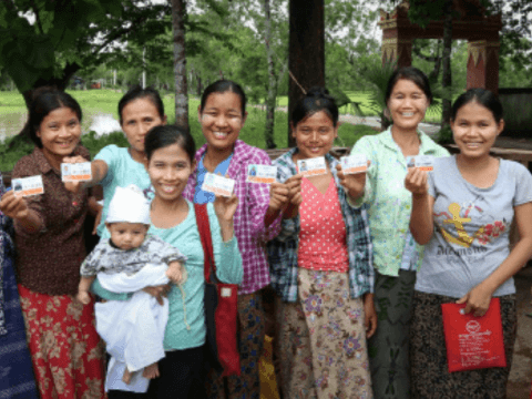 Women from Myanmar showing their Last Minute Mobile Solutions cards