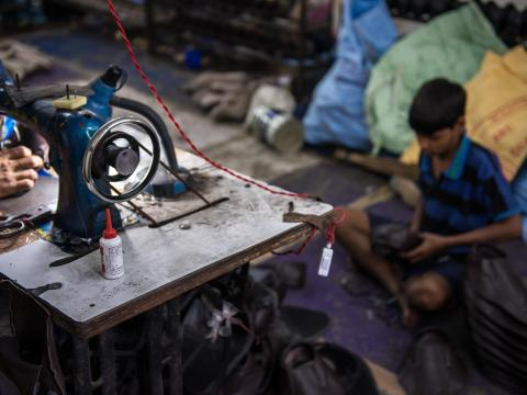 Jatin, 13, works in a textile factory in India