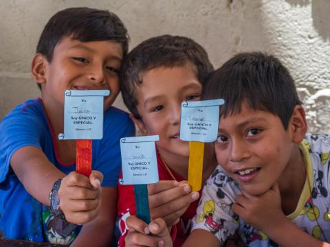 Jairo (9), Geral (7) and Javier (9) learn about their rights at a World Vision project in Peru. They must be cared for, protected and live without any kind of violence against them.