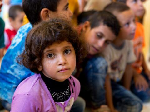 A girl in Syria sits in her classroom