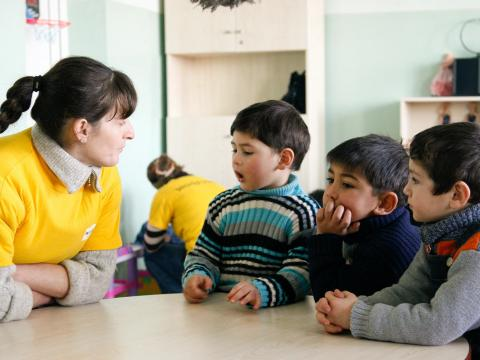 Georgia children at school with World Vision staff