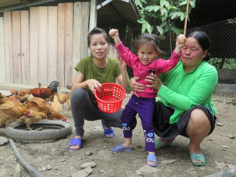 A family stands in their farm in Viet Nam