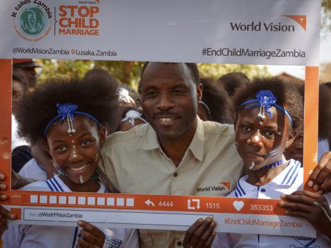 civic leader takes a picture with children at the launch of stop child marriage campaign in Mumbwa (2).jpg