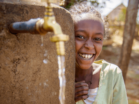Girls with running clean water