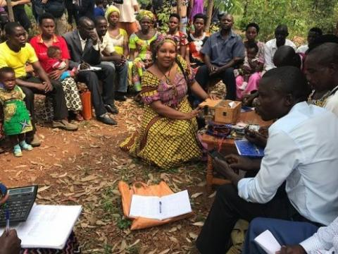 Women and men saving together in Rwanda. Angeline Munzara/World Vision