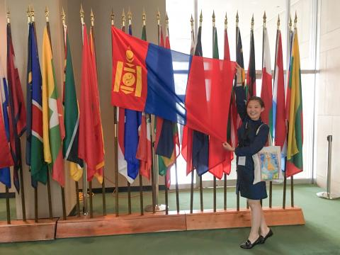 Mongolian girl at UN with her flag