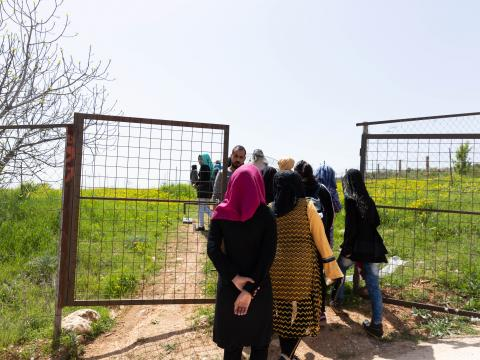 Young Syrian girls enrolled in the agriculture classes go to the field for their agriculture training.