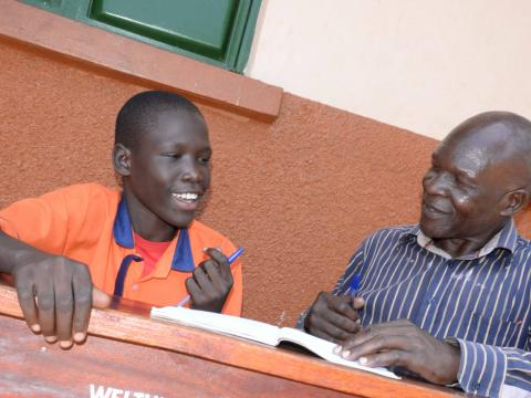 Solomon with his English teacher, he says he now lives life to its fullness