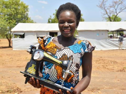 Mercy Leyo, 16, after receiving her startup kit from World Vision