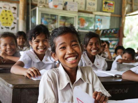 Khmer female student smiles along with classmates in rural province Cambodia