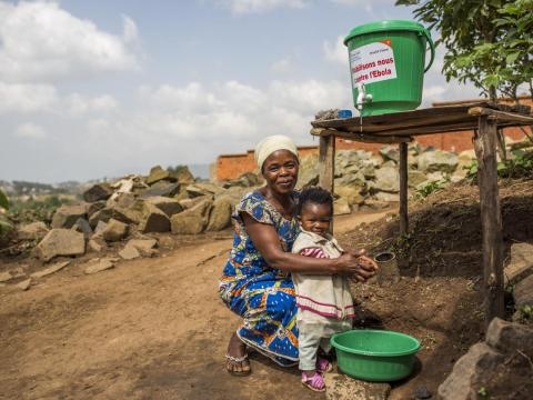 Child orphaned by Ebola washes her hands