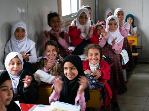 Girls clapping in a Child Friendly Space in Iraq