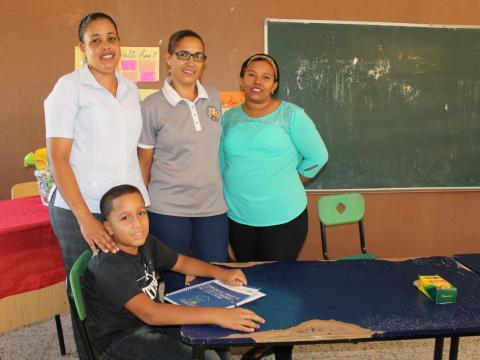 Yadiel and some of his teachers in a classroom