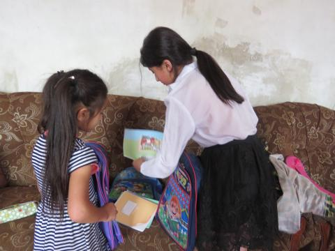 Girls having received school bags from Carrefour