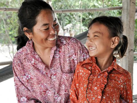 Khmer mother and daughter smile at each other