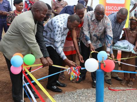 The Minister Peter Bhembe cutting the ribbon marking the official opening of the water scheme