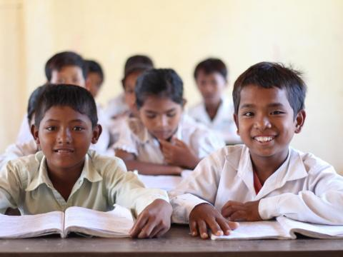 Khmer boys sitting at their desks in class, Cambodia