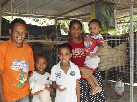 Alarico and Alzira with their children, Fersilia (aged eight), Bruno (aged 13) and Antonio (aged four) in front of their chicken coop. Photo: Jaime dos Reis/World Vision