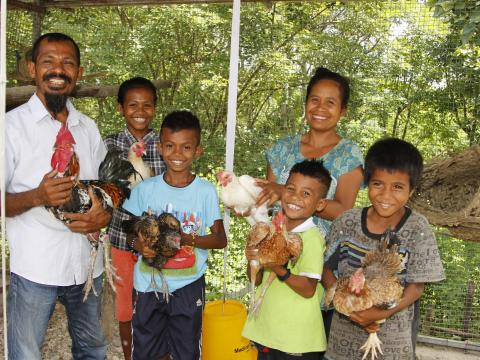 Tito, his wife Zulmira, and their four children (left to right) Sandra, 15, Ronaldo, 12, Floriano, 8 and Noberto, 10, with their flock of chickens. Photo: Jaime dos Reis/World Vision