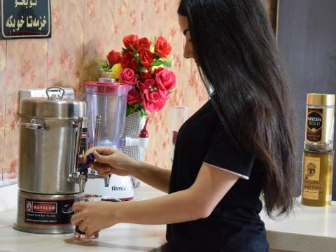 Reema while serving tea at Sewan Private Center, a women's beauty and fitness center.