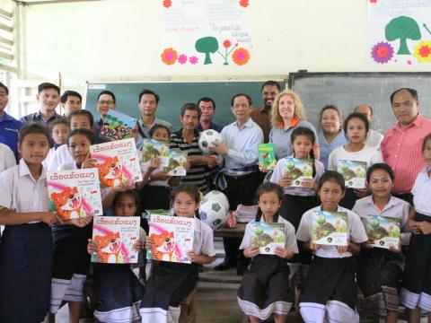 Handing over story books and Sport equipments to the school Principal