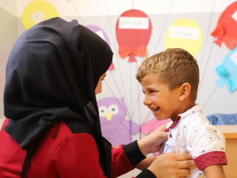 A refugee child in Syria is seen by a doctor