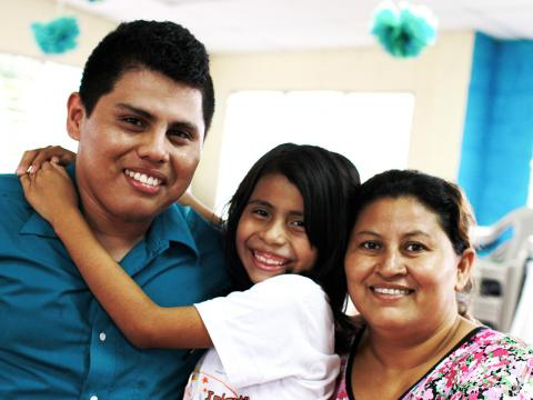 Elisa Gamero and Miguel Artiga with a child in El Salvador