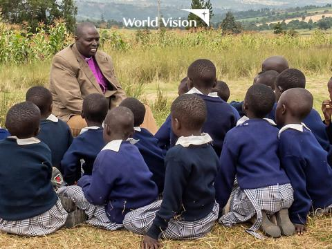 Dr.Jackson Ole Sapit,the head of the Anglican Church in Kenya (ACK) inspiring school children in Narok County. ©World Vision Photo