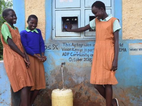 Children at a water point constructed by World Vision