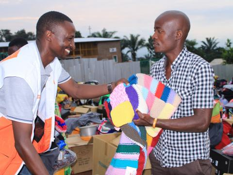 HEA manager distributing charities to those affected by floods in Bujumbura