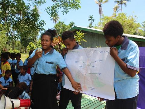 Lucy and her school mates from their DRR Club during in awareness on how a volcano may create a disaster.